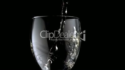 White wine pouring into wine glass