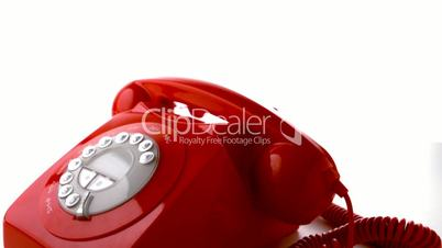 Red phone receiver dropping on dial phone