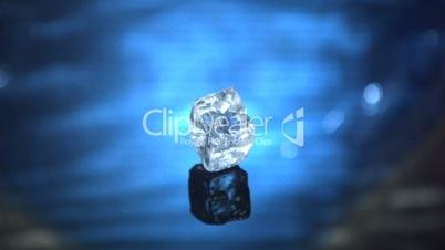 Ice cube falling in water