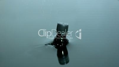 Medicine jar falling into water