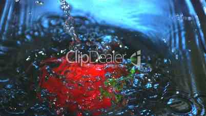Red bell pepper falling into water