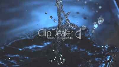 Medicine jar falling into blue water