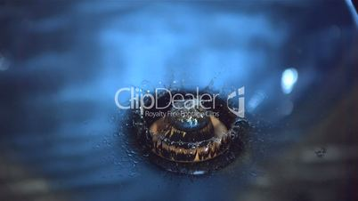 Wooden ring falling into blue water