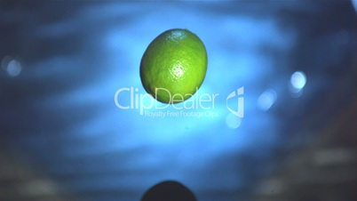 Lime fruit falling in water