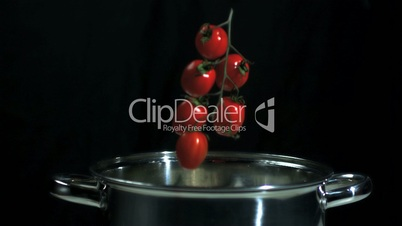 Jalapeno chili falling into a pot
