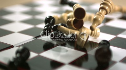 Chess pieces falling on board