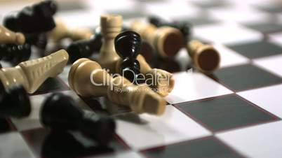 Chess pieces thrown across the board