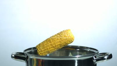 Corn falling into a saucepan