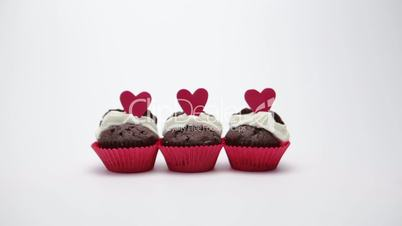 Three valentines cupcakes on white background