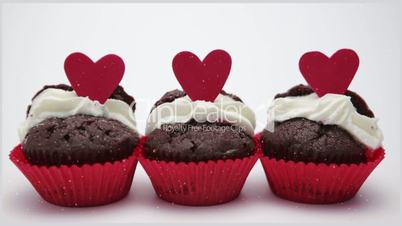 Three valentines cupcakes on white background close up