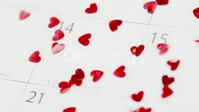 Confetti falling on calendar showing Valentines day
