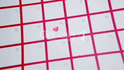 Pink heart marking out valentines day on calendar