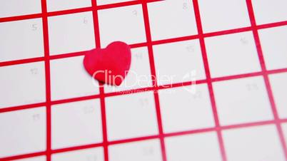 Pink heart marking out valentines day on calendar close up