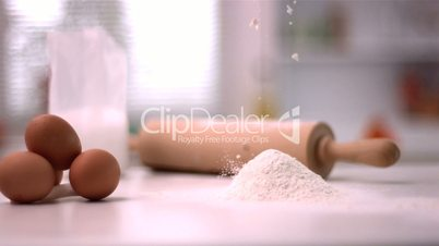 Flour sprinking on kitchen counter with baking tools