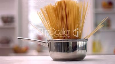 Spaghetti in a saucepan in kitchen