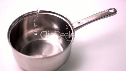 Water filling saucepan