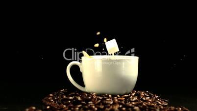 Sugar cube falling in coffee cup