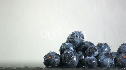 Water falling on blueberries