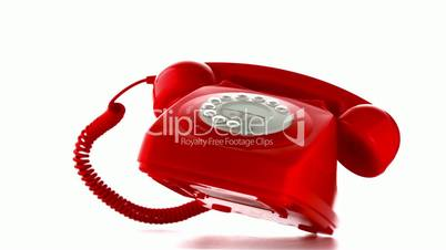 Red dial phone falling and bouncing
