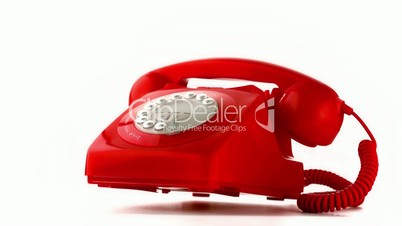Red dial phone falling and bouncing on white background