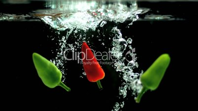 Chili peppers falling into water