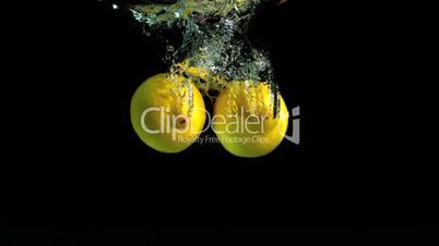 Lemons dropping in water