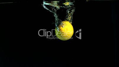 Hand taking lemon from water