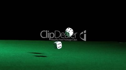 Dice falling and bouncing on green table