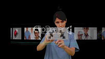 Nurse using digital interface to look at various x-rays