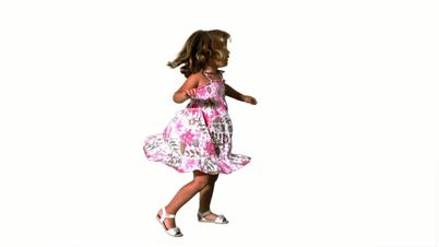 Girl twirling in floral dress