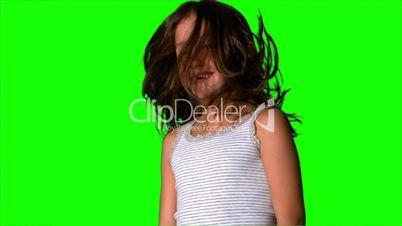 Little girl shaking her hair on green screen