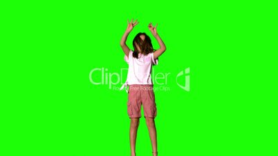 Girl jumping up on green screen