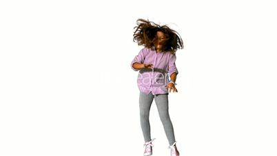 Happy little girl jumping on white background