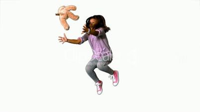 Happy little girl jumping up and catching teddy on white background
