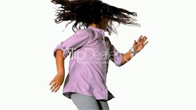 Girl jumping and spinning on white background