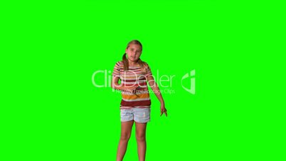 Girl jumping with limbs outstretched on green screen