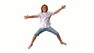 Boy jumping up and down on white background
