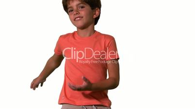 Close up of boy jumping on white background