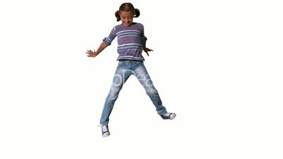 Smiling girl jumping up and down on white background