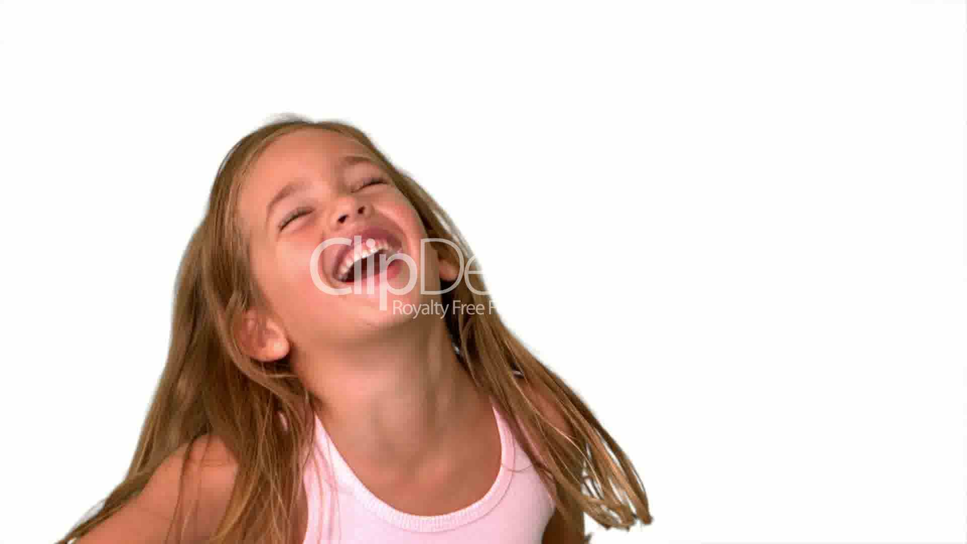 Close Up Of Little Girl Laughing And Turning On White -5450