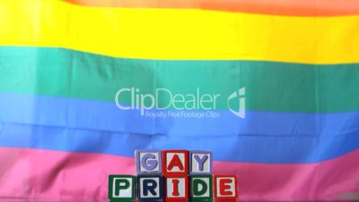 Rainbow flag blowing in the breeze with gay pride blocks
