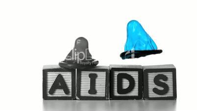 Condoms falling on blocks spelling AIDS