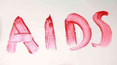 Hand painting the word aids in red paint