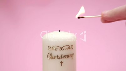 Christening candle being lit