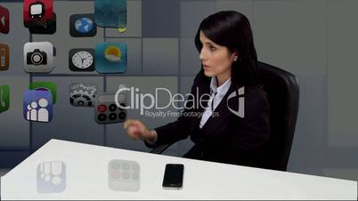 Businesswoman sitting at desk and scrolling through applications