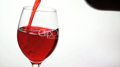 Glass being filled with red wine