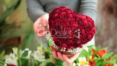 Florist Arranging Valentines Day Rose Heart Bouquet Closeup
