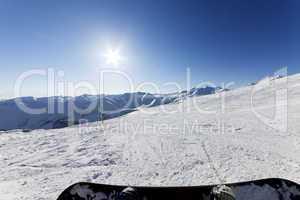 Snowboarder resting on ski slope