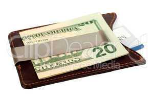 Dollars in money clip and credit card.