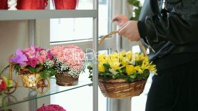 Customer Purchasing Flower Arrangement In Florist Shop
